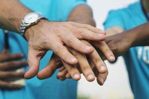 Team of volunteers stacking hands