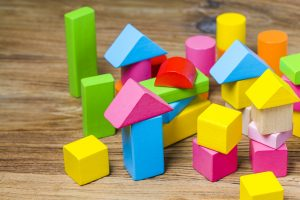 Building blocks on wooden background,Colorful wooden building